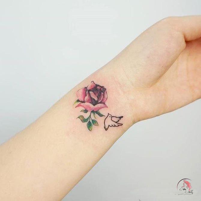 Hình xăm hoa hồng ở cánh tay